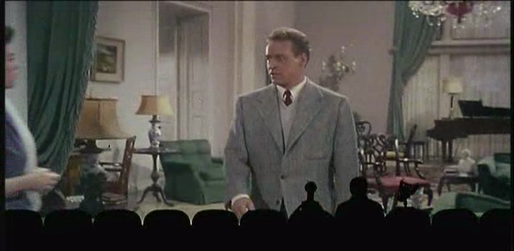 Screenshot of MST3K The Movie, watching This Island Earth, as Rusell Johnson appears on screen.