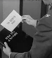 image from Twilight Zone Episode, To Serve Man, showing the book with the alien title on the front and its translation.